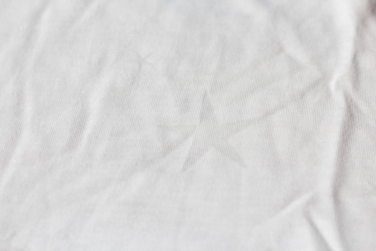 Close up of a white shirt with burnout star pattern