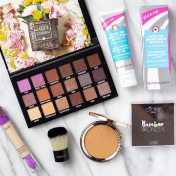 All of the items from the May 2021 boxycharm base box displayed on a marble background