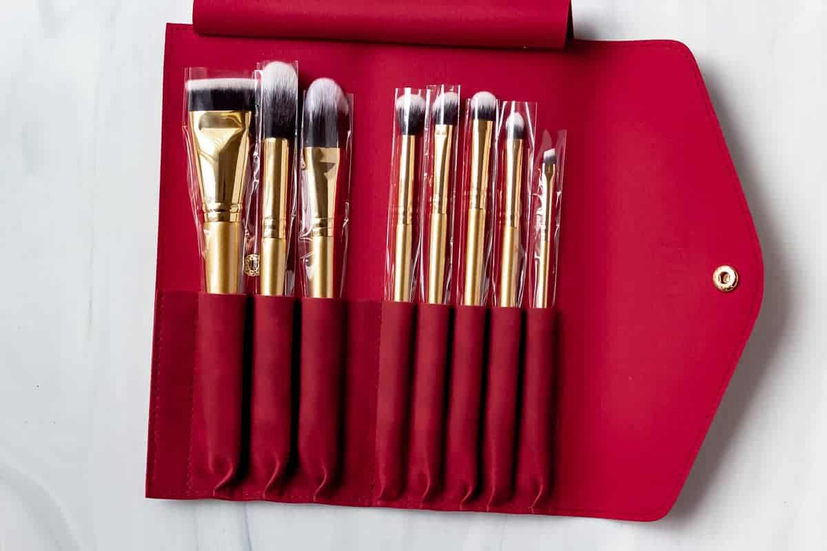 Luxie Glitter and Gold Brush Set in a red case on a white background