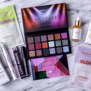 All of the items from my June 2021 Boxycharm box on a marble background