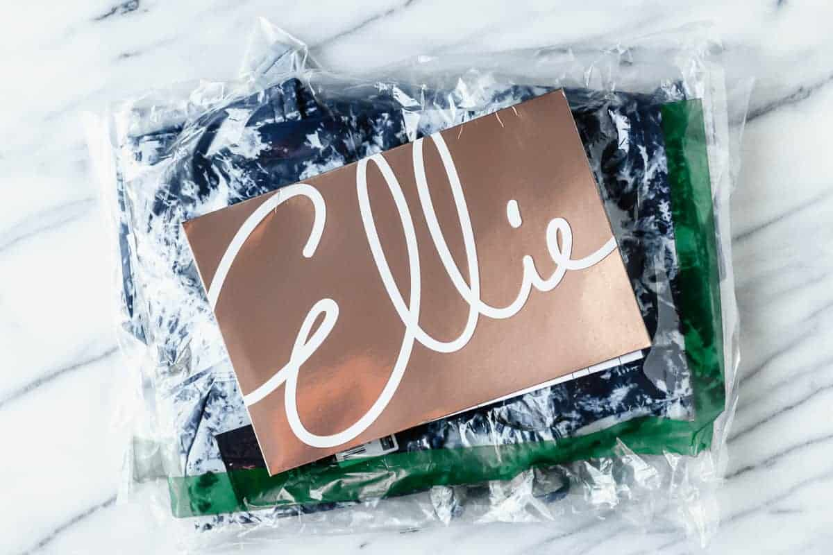 Ellie bags of clothes with the insert card on top