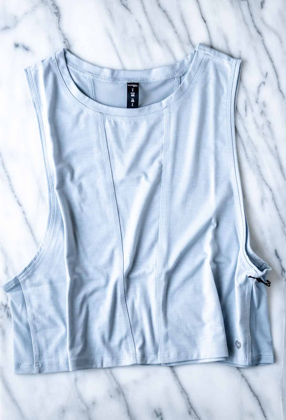 Wildfox Sweat Corrine Cropped Top on a marble background