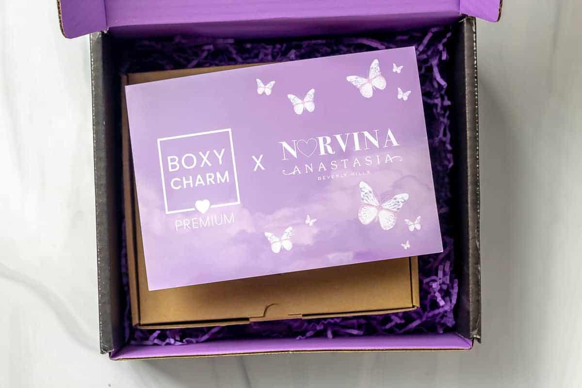 July 2021 Boxycharm premium with the insert card on top of the items inside