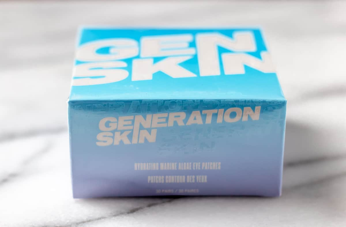 Generation Skin Marine Algae Eye Patches package on a marble background