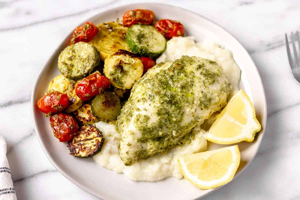 Sheet Pan Chicken with Basil Mashed Potatoes & Roasted Zucchini Squash from Gobble on a white plate