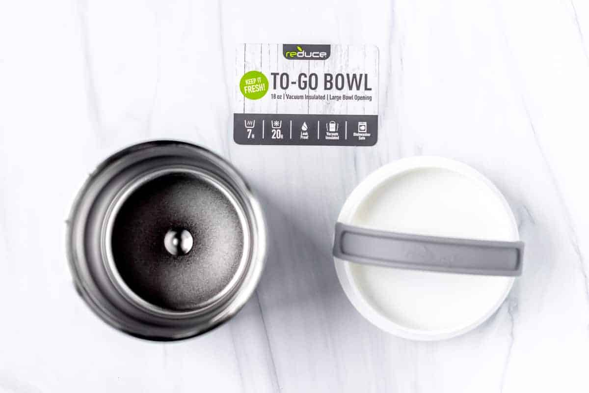 Opened Reduce By Reduce To-Go Bowl with the insert card on a white background