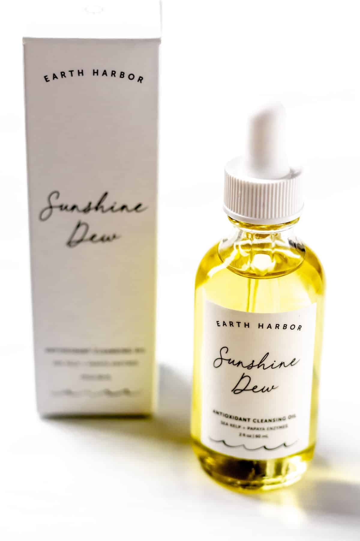 Earth Harbor Naturals Sunshine Dew Antioxidant Cleansing Oil bottle and box on a white background