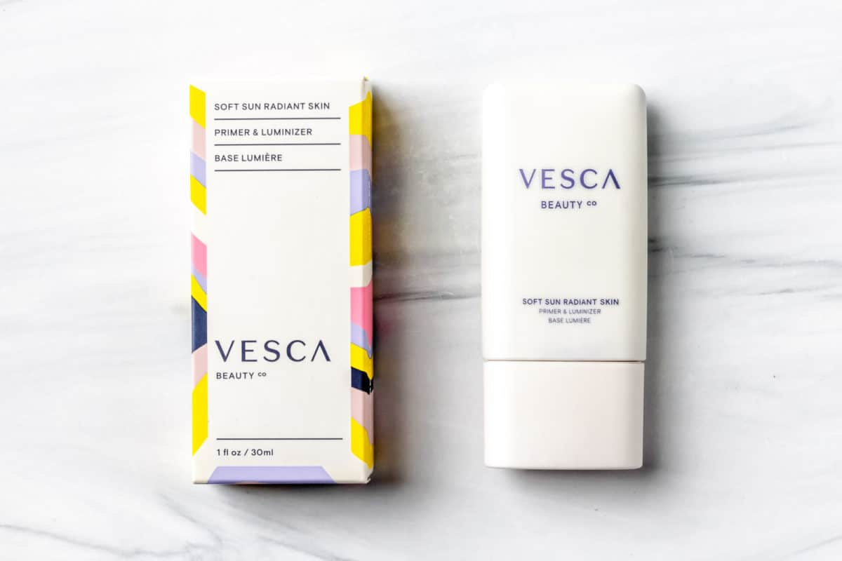 Vesca Beauty Soft Sun Radiant Skin Primer & Luminizer in Glow bottle and box on a white background