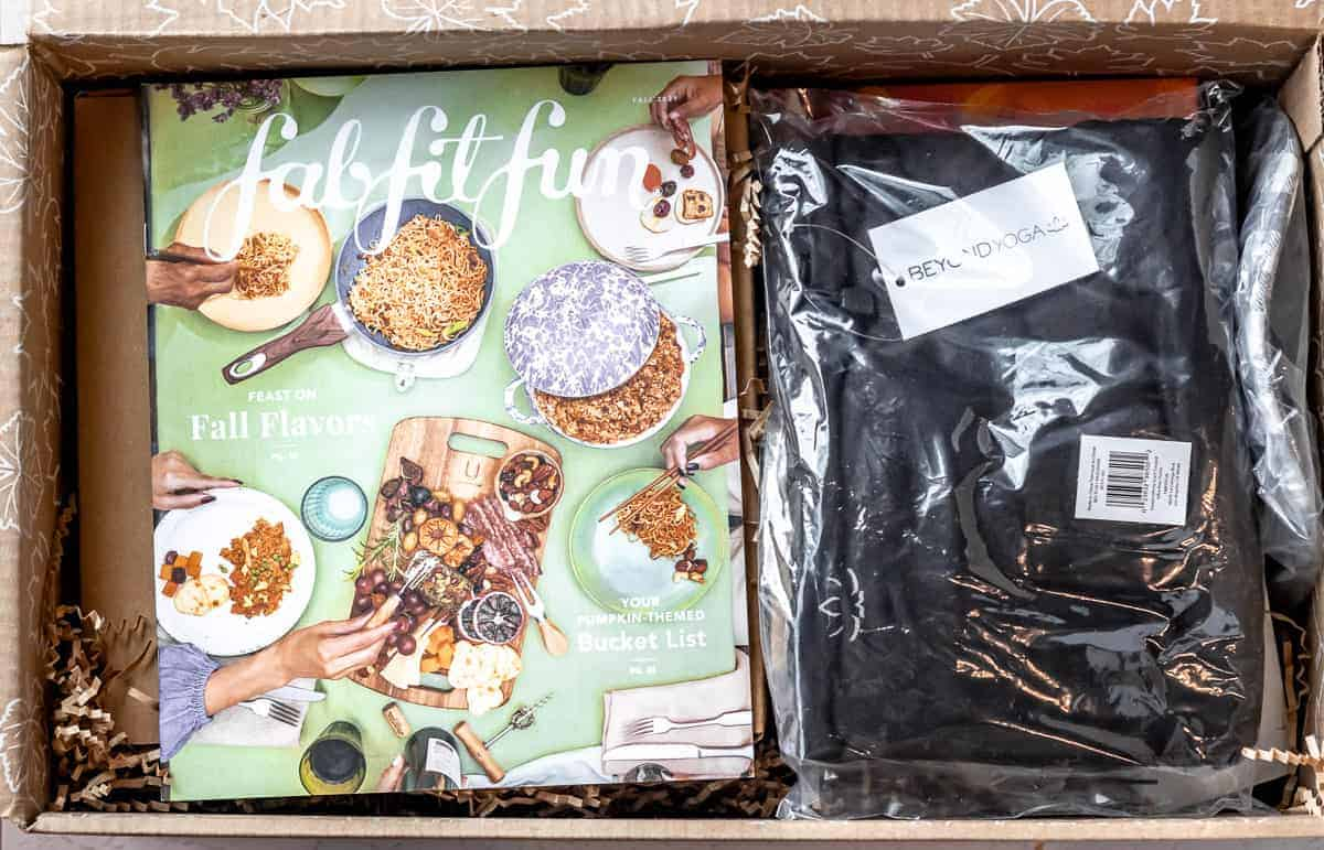 Opened fall 2021 fabfitfun box with the magazine and contents inside