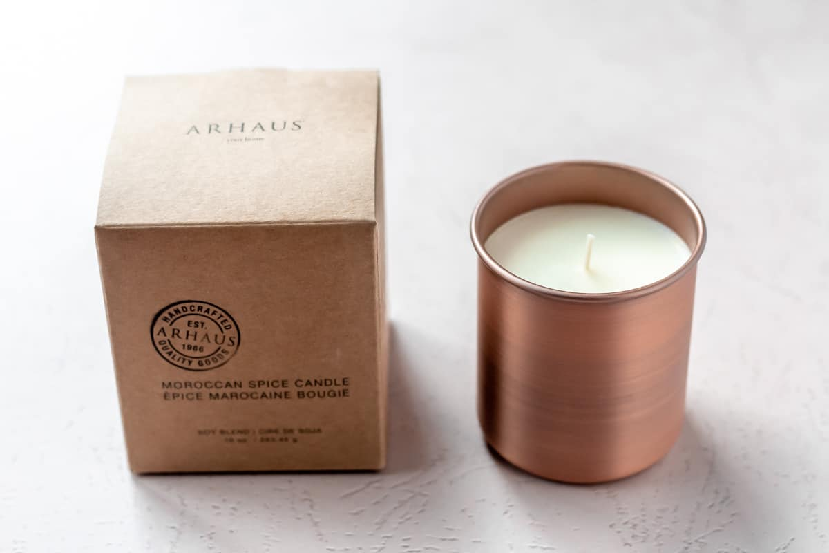 Arhaus Copper Candle in Moroccan Spice with the box on a light background