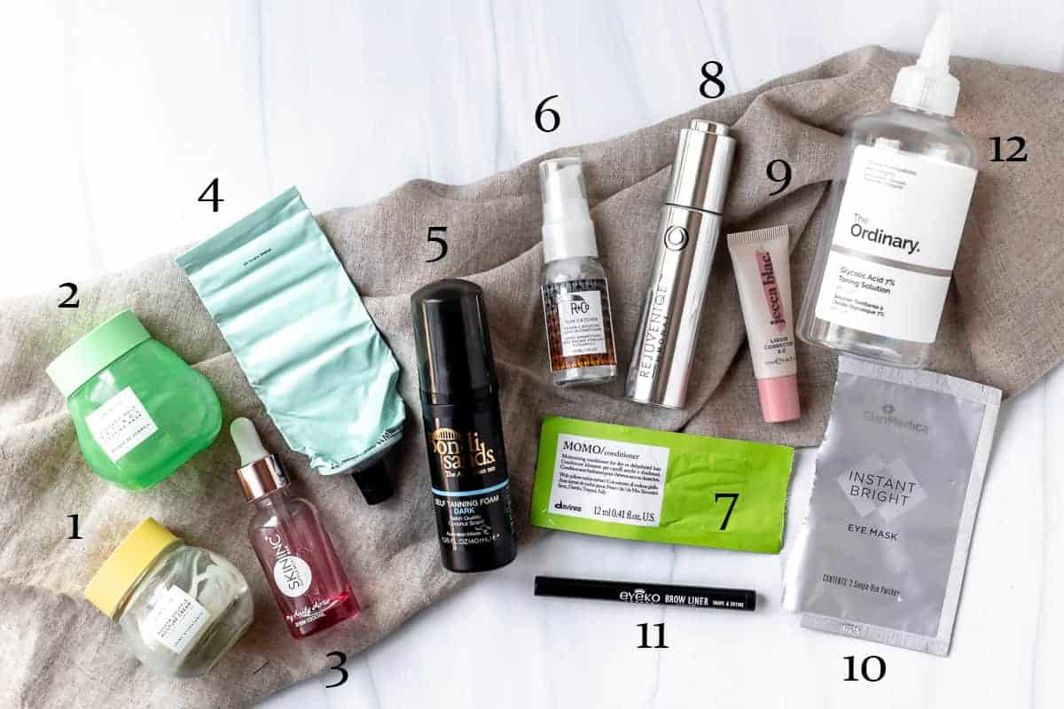 My July 2021 beauty empties products laid out with text overlay