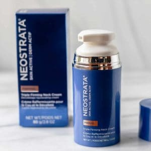 Neostrata triple firming neck cream box, bottle with the lid off and cap on a white background