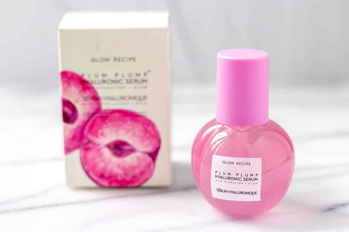 Glow Recipe Plum Plump Serum bottle and box on a white and gray background.