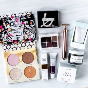 All of the products from my September 2021 Boxycharm Premium box laid out on a white surface.