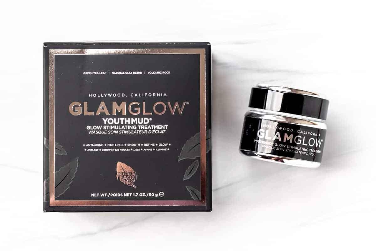 GLAMGLOW Youthmud Glow Stimulating & Exfoliating Treatment Mask box and jar on a white background.